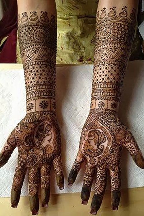 A Beautiful Cocktail of Portrait and Floral Mehendi Design
